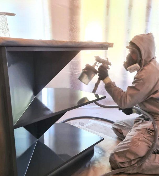 Spray Painter Spraying Kitchen
